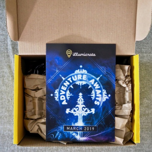 Opened Illumicrate box, with booklet on display.